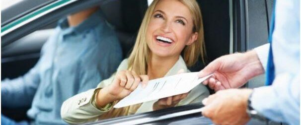 a happy woman with her driver's licence